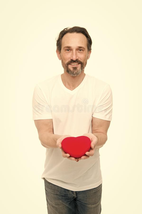 Love and romantic feelings concept. Heart attribute of valentine. Heart gift present. Greeting from sincere heart. Man stock photography