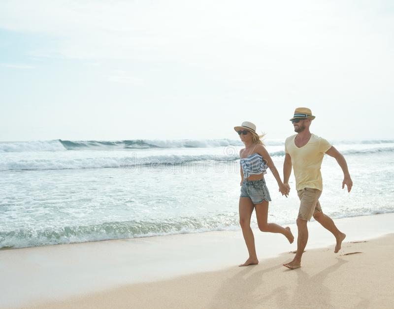 Love. Running couple on the beach stock images