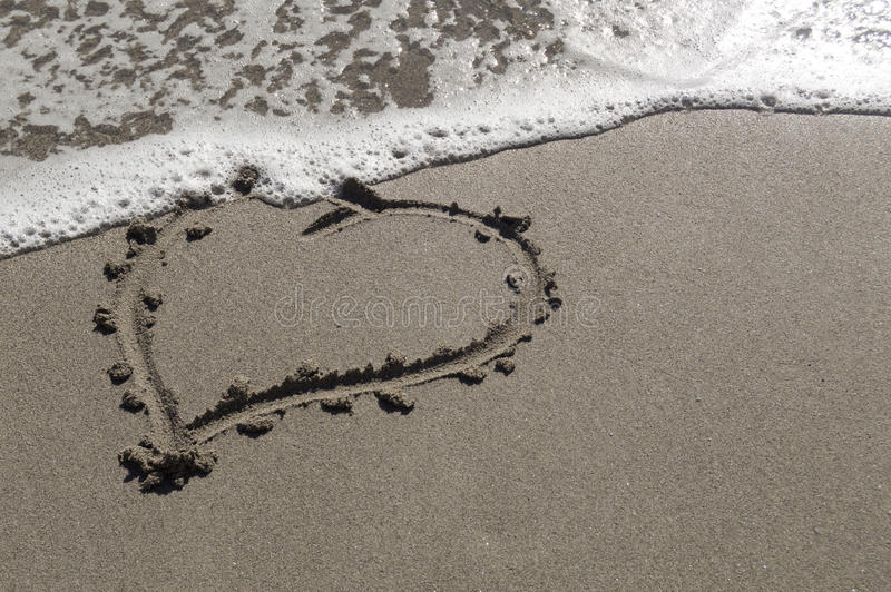 Love in sand stock images