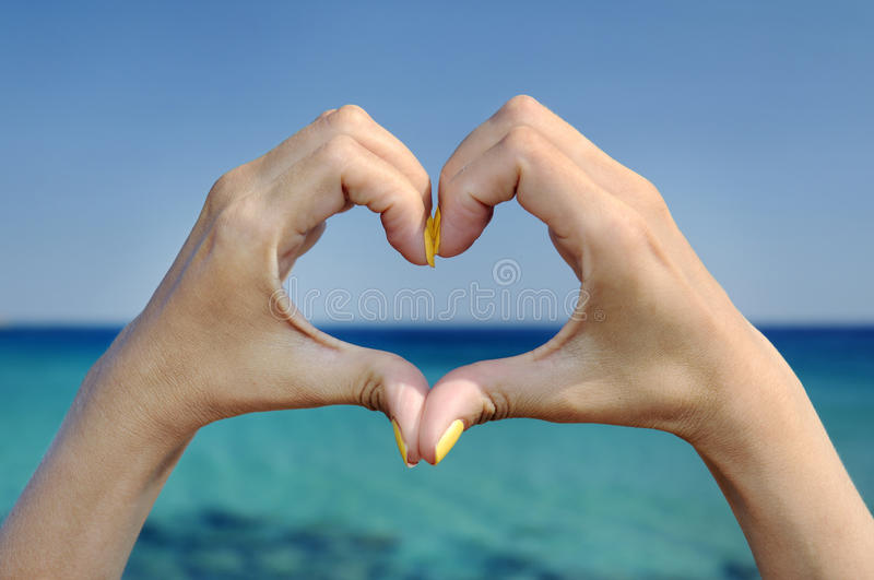 Love sea hand heart gesture. Love sea and vacation hands heart gesture stock photography