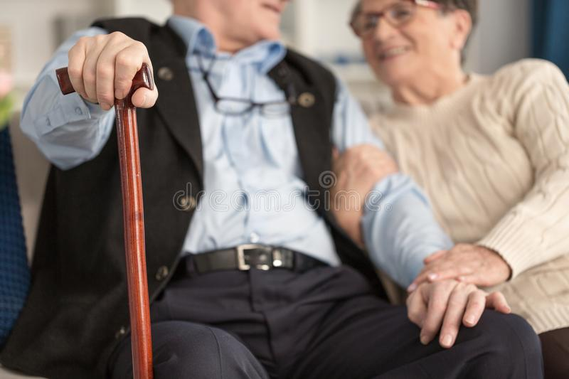Love in senior house. Love between two old-aged people in private senior house royalty free stock photo
