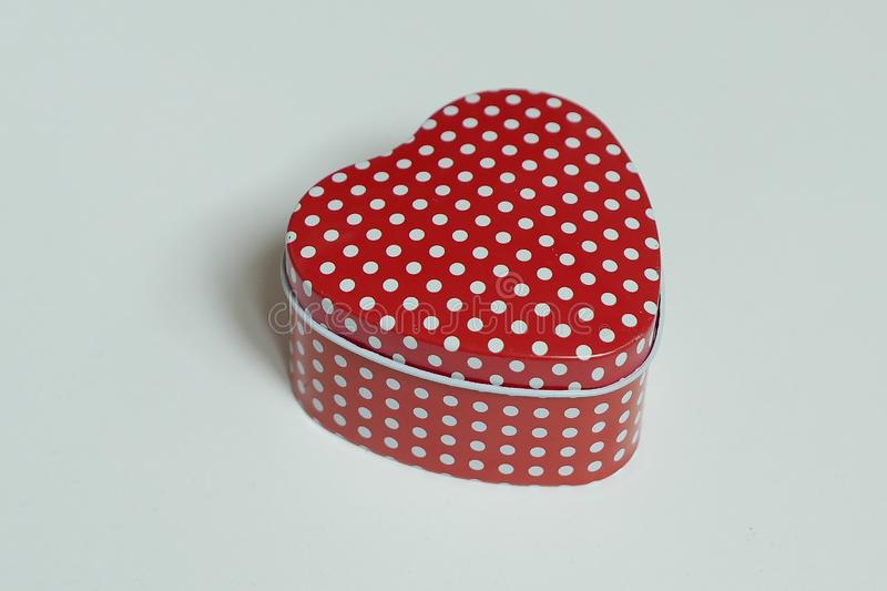 Love shape container with red and white polka dot isolated on white background.  stock photography
