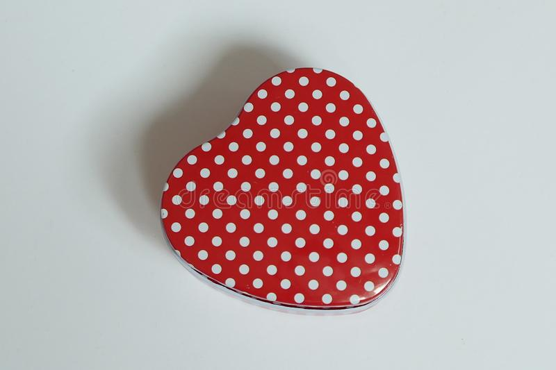 Love shape container with red and white polka dot isolated on white background.  stock image