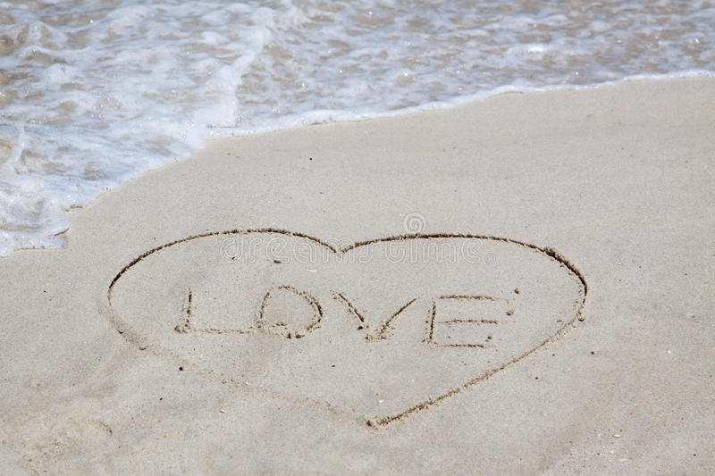 Love sign. On a ocean beach stock photography