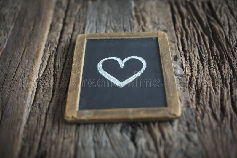 Love sign on chalkboard. royalty free stock images