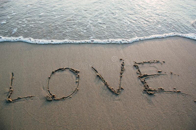 Love sign on sandy beach royalty free stock photography
