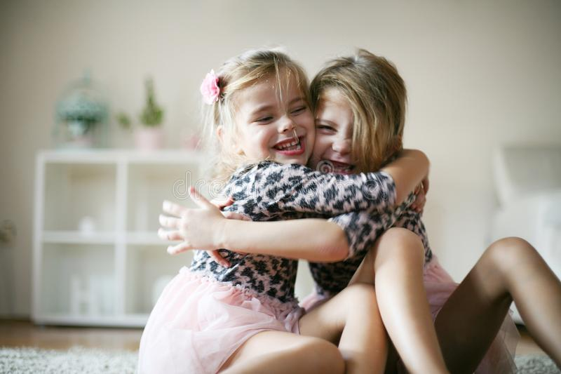 Love of sisters. Two little girls at home. Close up stock image