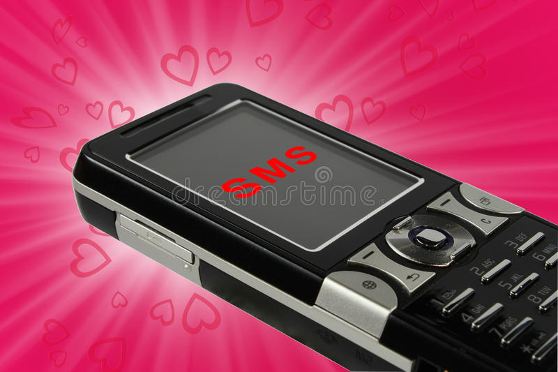 Love sms. Cell phone with incoming love sms on pink background royalty free stock images