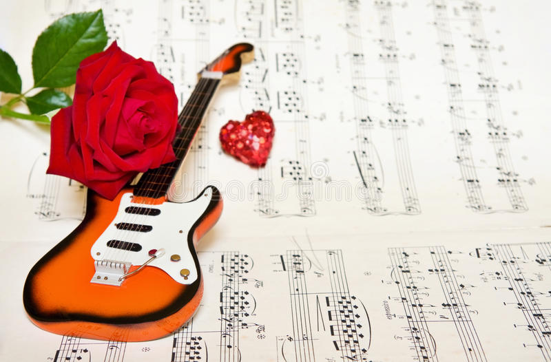 Love song with guitar and rose stock photography