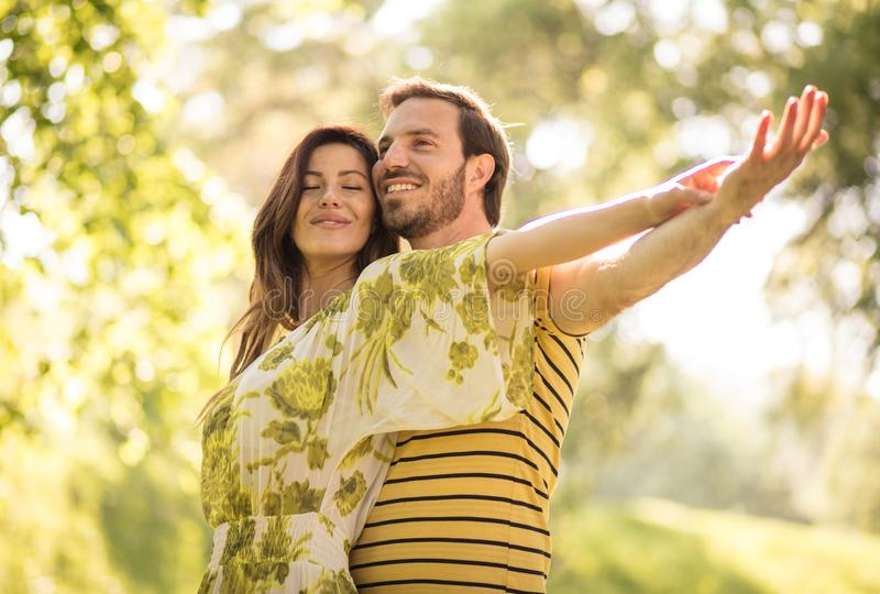 In love at spring season. Happy middle age couple. Beauty in nature royalty free stock photo