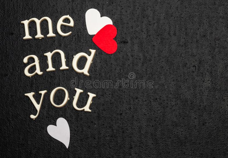 Love statement and Inspirational quote, reads me and you. Black background. White and red hearts. Text space. Love statement and Inspirational quote, reads me stock photos