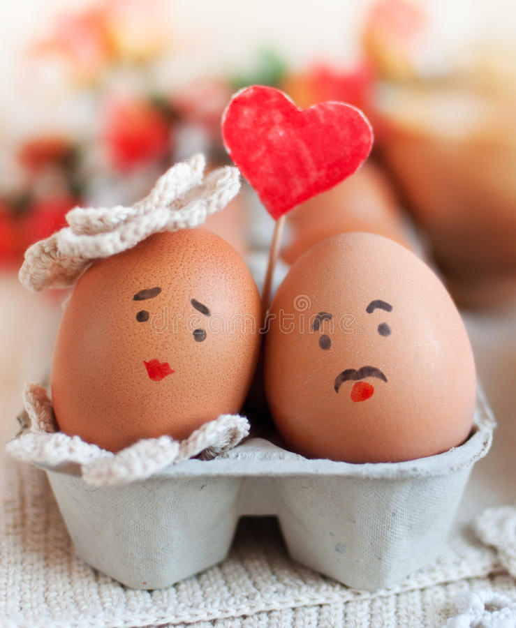 Love story. Sweet couple egg staying close to each other with love royalty free stock photos