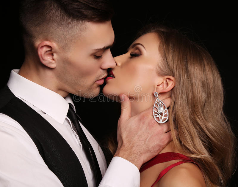Love story. beatiful couple. gorgeous blond woman and handsome mann. Fashion studio photo of beautiful couple in elegant clothes, gorgeous women with long blond royalty free stock photography