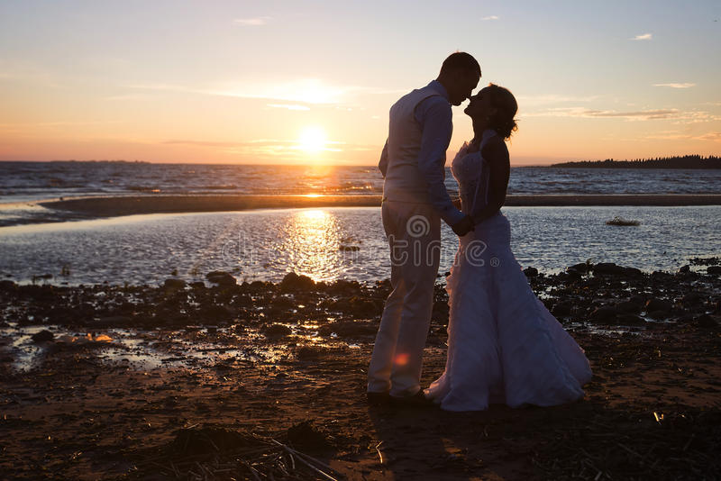 Love story couple wedding on sunset sea. Outdoor royalty free stock photography