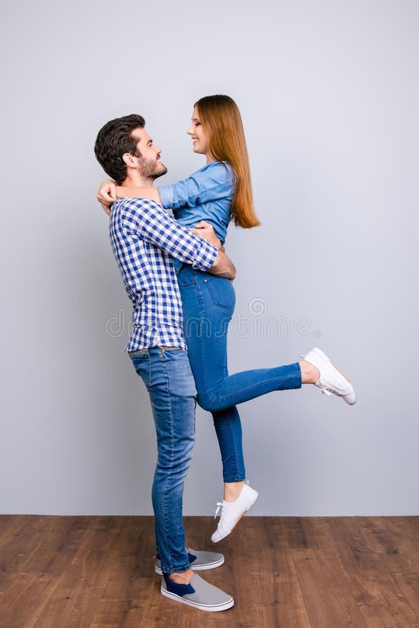 Love story. Full length portrait of dreamy happy young couple in royalty free stock photo