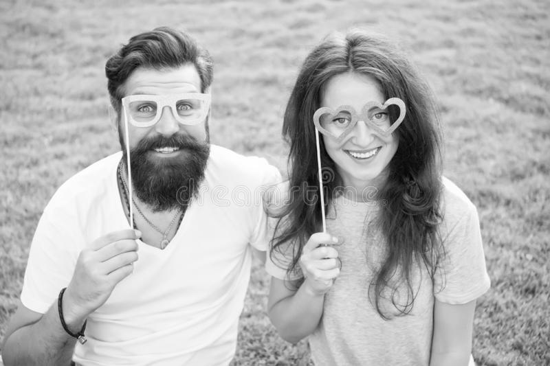 Love story. Happy together. Couple in love cheerful youth booth props. Couple relaxing green lawn. Man bearded hipster royalty free stock photo