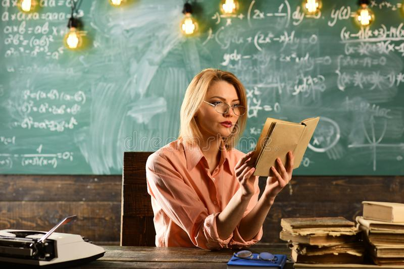 Love story novel book in hand of woman at school lesson. love story writing by pretty woman. stock photography