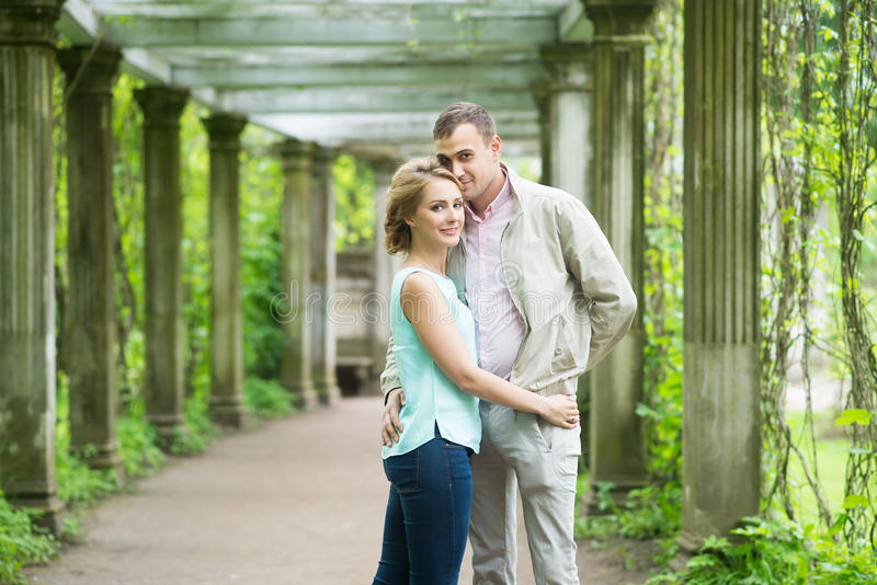 Love story. Romantic couple in relationship in park, garden. Autumn royalty free stock images