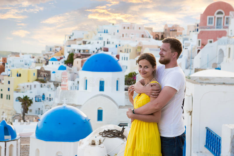 Love story Santorini. Young couple honeymoon on the most romantic island Santorini, Greece. Sunset in the city Oia stock images