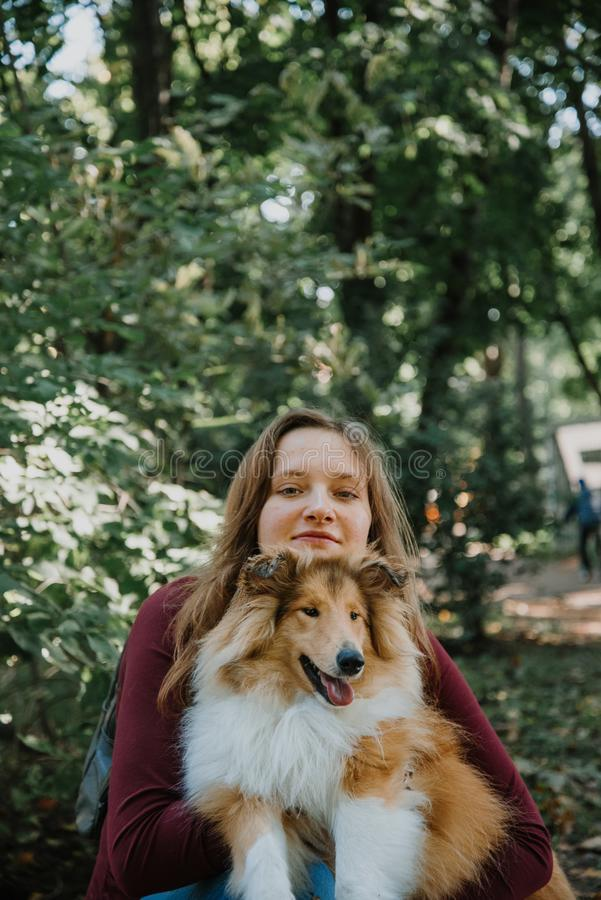 Love story. stroll. beloved family and dog. future mom and dad royalty free stock photos
