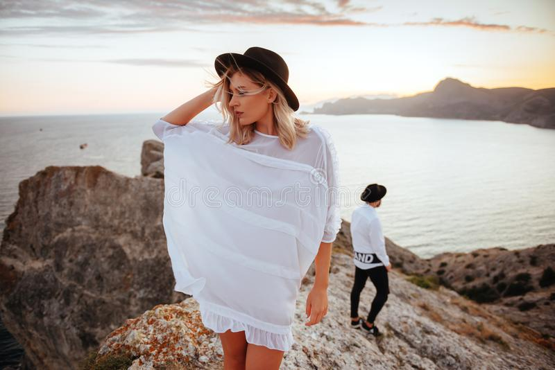 Love story on sunset. Romantic summer love story on a sunset in mountains. Young girl and boy in love royalty free stock photo