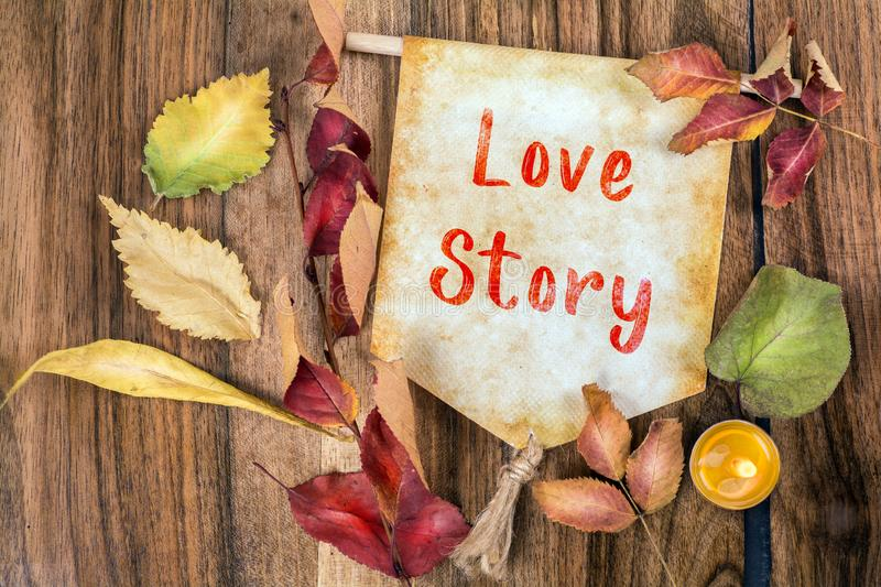 Love story text with autumn theme stock image