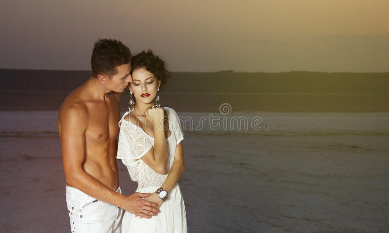 Love story of young beautiful couple. Love story of young beautiful couple, who walking together on the nature royalty free stock photos