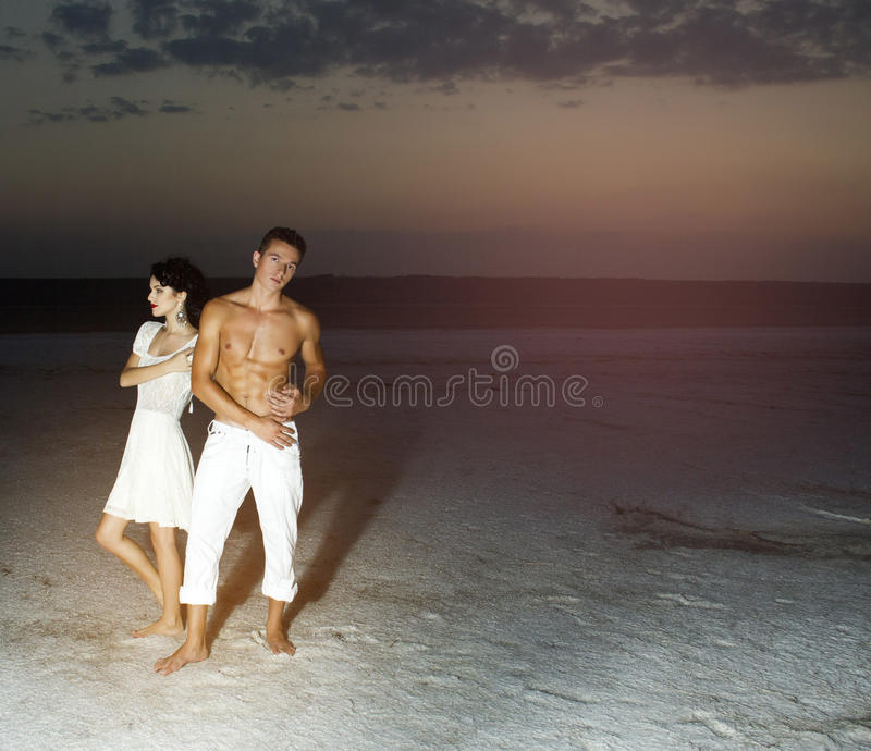 Love story of young beautiful couple. Love story of young beautiful couple, who walking together on the nature royalty free stock photography