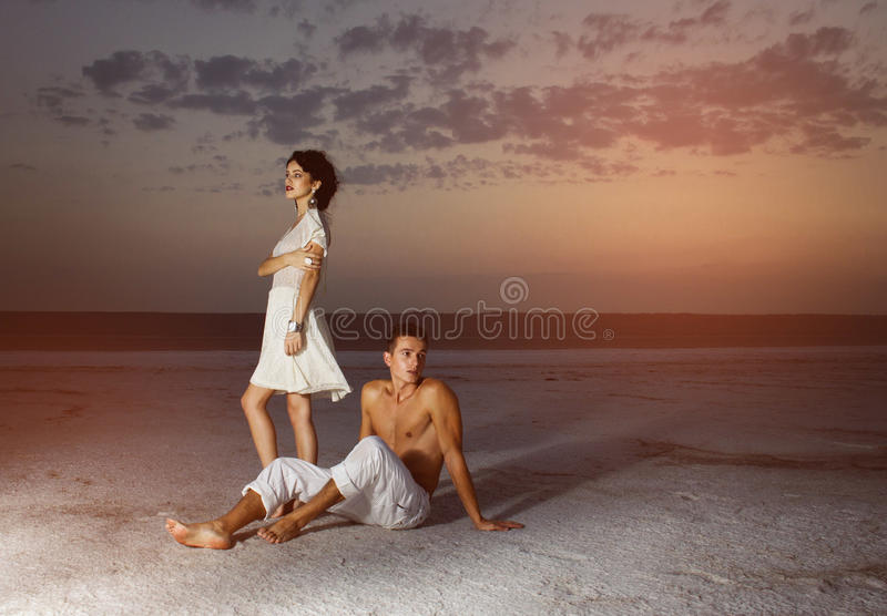 Love story of young beautiful couple. Love story of young beautiful couple, who walking together on the nature royalty free stock images