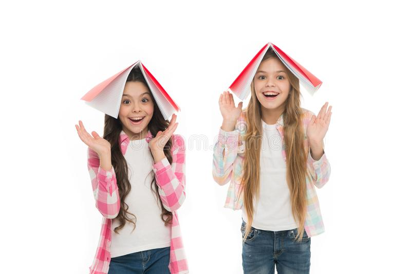 We love study. Pupils carrying textbooks to school classes. Studying is fun. Buy book for extra school course. Language royalty free stock photo