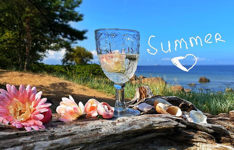 Love Summer Romantic Season Wild tree Autumn leaves and stone on beach sand red Rowanberry and glass of fresh wat. Love Summer Hello Autumn Romantic Season Wild royalty free stock photo