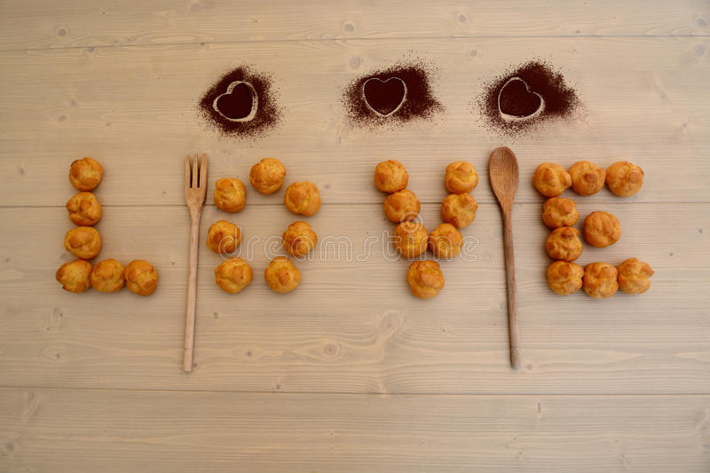 Love and sweets. Top view of heart shaped chocolate and sweets in breakfast table royalty free stock photo