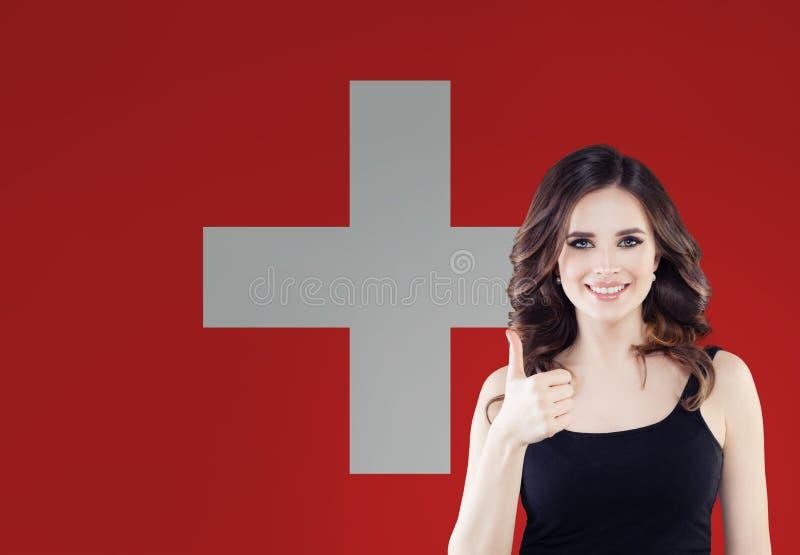 Love Switzerland. Happy woman on swiss flag background.  stock image