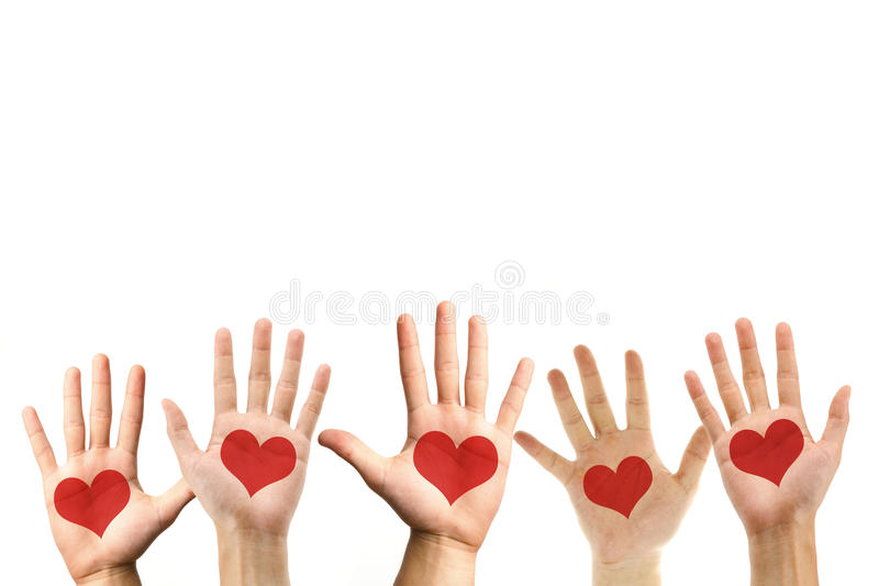 Love symbol on hand palm royalty free stock photo