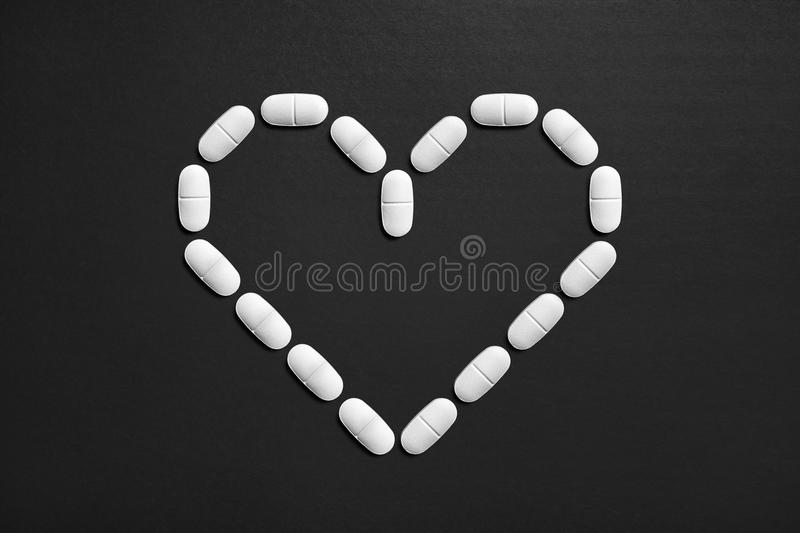 Love symbol made from pills. stock photography