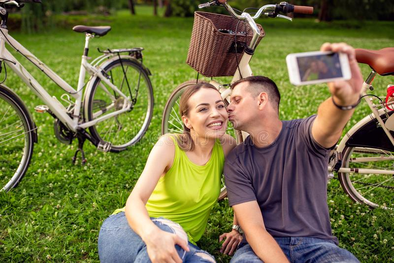 love, technology, relationship, family and people concept - young couple taking selfie. royalty free stock images