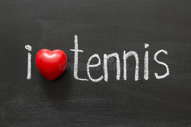 Love tennis. I love tennis handwritten on the school blackboard stock photo