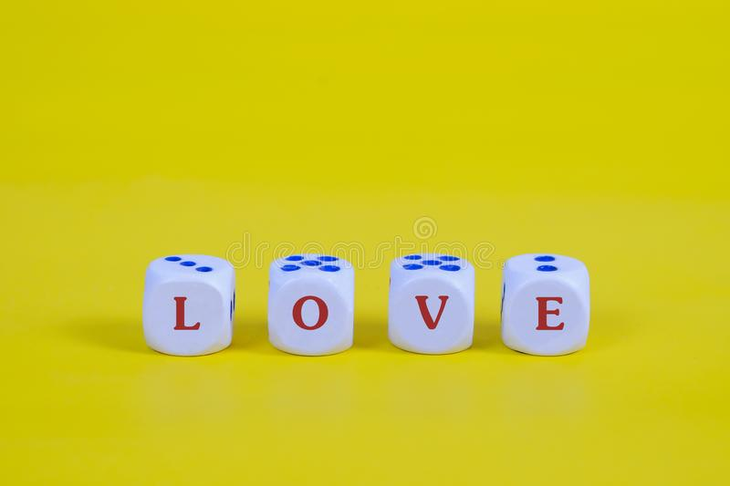 Love text on dice with color background. Red Love text on dice with color background stock photos