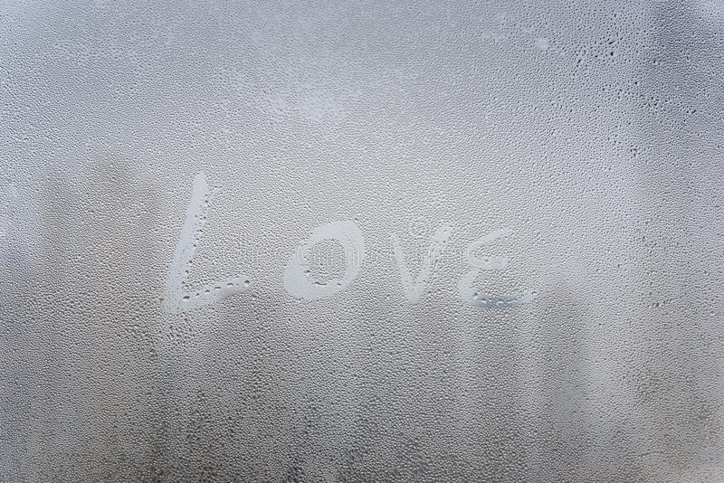 Love text draw on surface of window. In citysacpe view text draw on surface of window in citysacpe view royalty free stock image