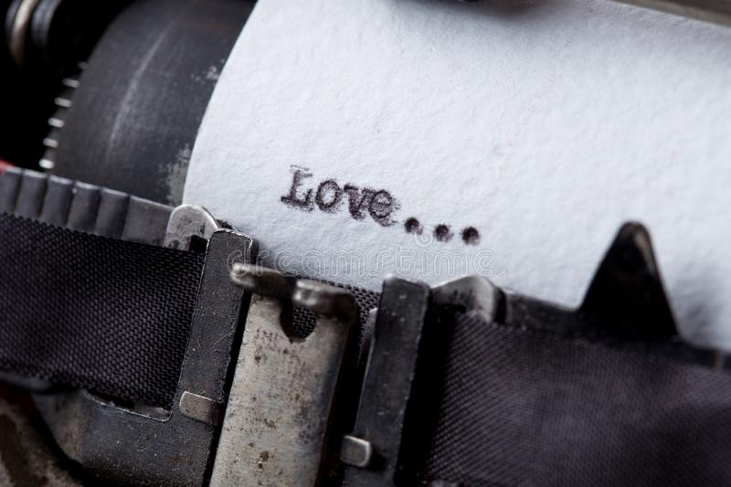 love - text message on the typewriter close-up royalty free stock photography