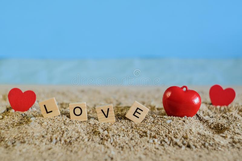 Love text on wood with tropical sand beach ,love concept. And soft focus royalty free stock photos