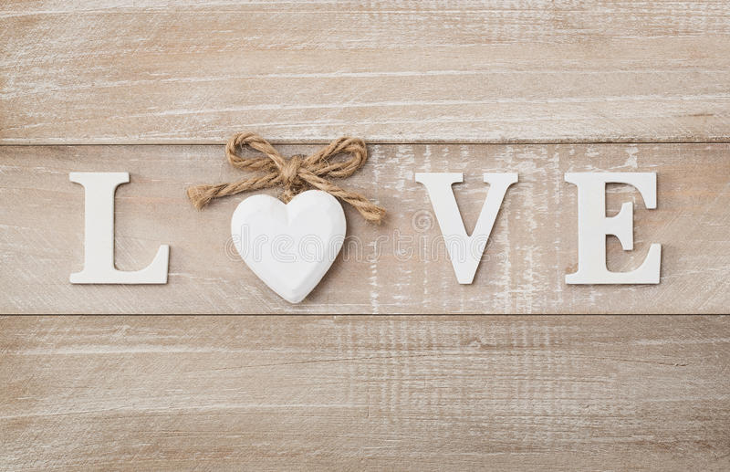 Love text. Love wooden text on vintage board background with copy space royalty free stock photography