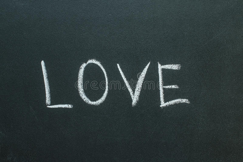 Love text written on chalkboard. Valentine`s Day Concept royalty free stock images