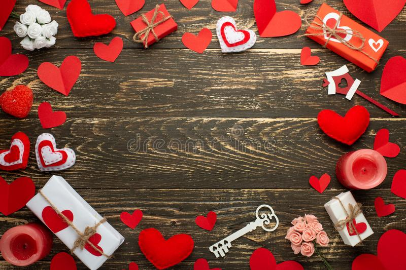 Love, texture with red hearts, candles, gifts for lovers on a wooden background. Valentine`s Day. Flat-lay, top view, copy space royalty free stock image