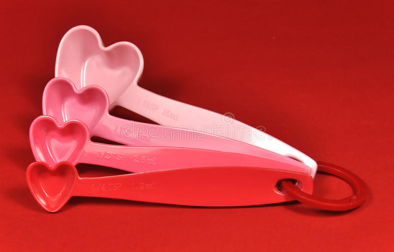 Love theme pink and red heart shape measuring spoons
