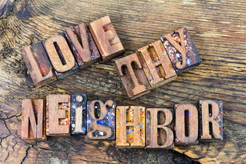Love thy neighbor family message. Love your neighbor everyone religious quote message religion people sign letterpress barn wood block letters words stock photo