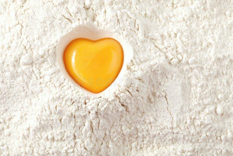 Love to bake it! egg yolk on flour stock photos