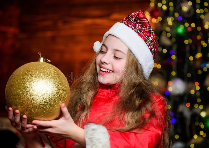 Love to decorate everything around. Sparkling big toy. Merry christmas. Festive atmosphere christmas day. Girl santa. Claus costume hold big ball christmas tree stock images