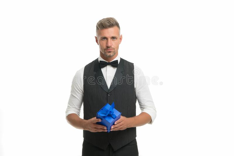 With love to our customers. Womens day. Valentines day. Gentleman delivering gift. Handsome man with wrapped gift box stock image