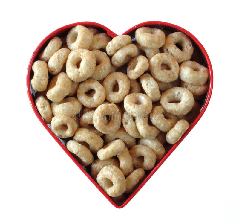 Love That Toasted Oat Cereal. Toasted Oat Cereal in Heart Shaped Cookie Cutter stock photos